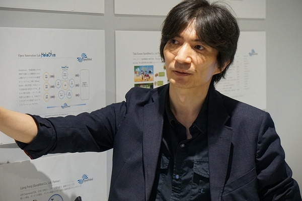 鎌田卓(SpiralMind 代表取締役) 3Di OpenSimやADN Cloud Heart for Unity等の仮想空間を相互接続するインターバースや 複合現実技術(Mixed Reality)を研究。